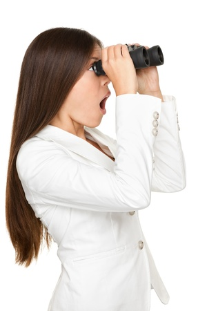 binoculars view: Side view of surprised young businesswoman looking through binoculars isolated over white background Stock Photo