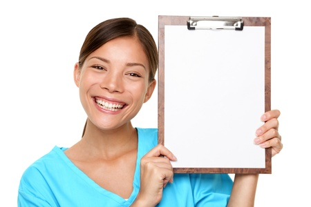 Portrait of happy female doctor holding blank paper on clipboard isolated over white background photo