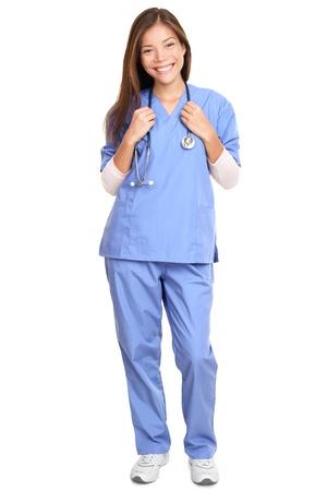 医者。若い女性外科医の医師や看護師首立っている白い背景で隔離の周り聴診器での完全な長さの肖像画 写真素材