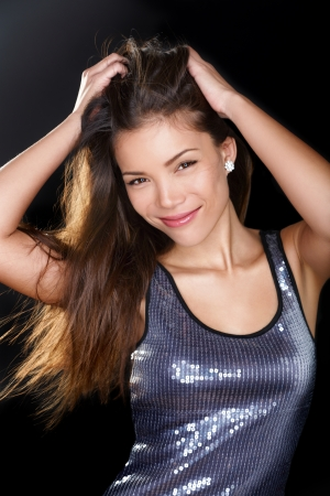 Beautiful multiracial Asian Caucasian female model in party dress on black background Stock Photo - 20785034
