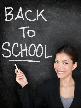 teaching and learning: Back to school chalkboard blackboard teacher or woman university student  Female school teacher teaching pr college student girl writing Back to School text  Multi-ethnic Asian Caucasian model in suit Stock Photo