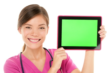 nurse computer: Medical nurse doctor showing tablet pc computer green screen with copy space Stock Photo