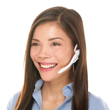 Headset customer service woman talking friendly smiling happy in call center on isolated on white background. Beautiful young mixed race Caucasian  Asian Chinese business woman working at hotline. photo