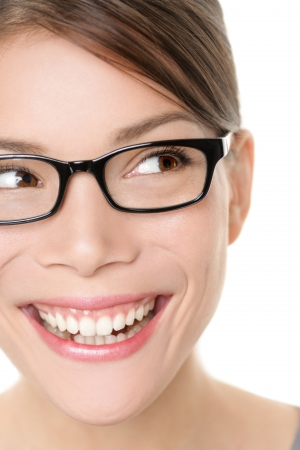 Glasses eyewear spectacles woman looking happy to side with big smile wearing eyeglasses. Close up portrait of female model face isolated on white background. Mixed race Asian Caucasian female model. photo