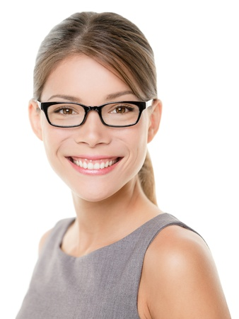optometry: Glasses eyewear woman happy portrait looking at camera with big smile. Close up portrait of female business woman model face isolated on white background. Mixed race Asian Caucasian businesswoman.