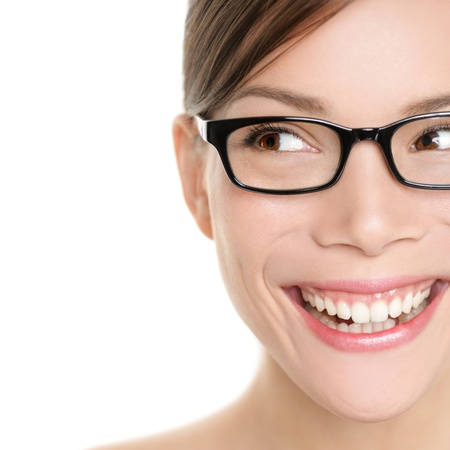 wearing glasses: Woman wearing glasses looking happy to side. Eyewear woman with big smile wearing eyeglasses. Close up portrait of female spectacles model isolated on white background. Mixed race Asian Caucasian girl