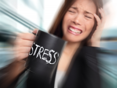 woman working out: Stress - business person stressed at office. Business woman holding coffee cup with STRESS written. Overworked and over caffeinated female businesswoman.