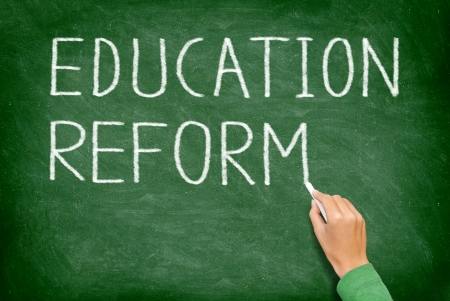 reform: Education reform - school reform concept blackboard. Teacher or student writing EDUCATION REFORM on green chalkboard. Primary school, secondary school, high school or college university.