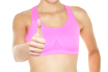 hand bra: Thumbs up fitness woman in sports bra close up. Closeup of female thumbs up hand sign gesture isolated on white background.