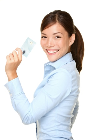 businesswoman card: Casual business woman holding showing credit card smiling happy in blue shirt. Young female professional showing empty blank credit card sign smiling happy at camera. Beautiful Asian Caucasian model.