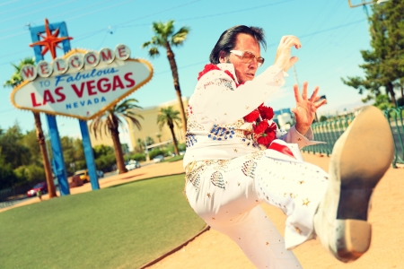las vegas casino: impersonator man in front of Welcome to Fabulous Las Vegas sign on the strip