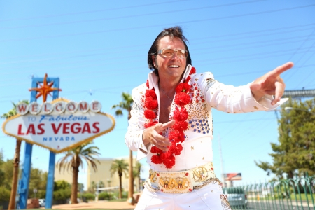 las vegas city: impersonator man and Las Vegas sign on the strip