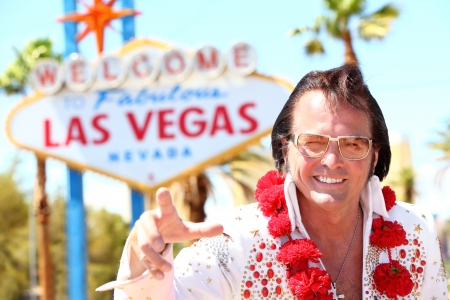 las vegas city: impersonator man in front of Las Vegas on the strip pointing looking at camera Editorial