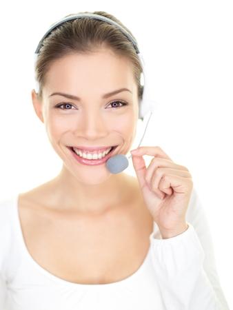 call center representative: Headset woman smiling call center customer service representative talking giving online help desk support Stock Photo