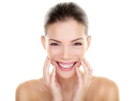 Beautiful Asian beauty woman touching perfect face skin laughing happy