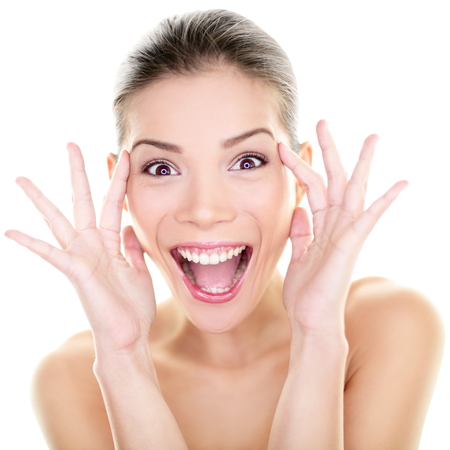 woman shouting: Beauty - happy funny Asian woman face expression  Girl surprised and excited showing fun facial expression  Beautiful healthy girl with perfect skin screaming joyful in surprise  Asian Caucasian model