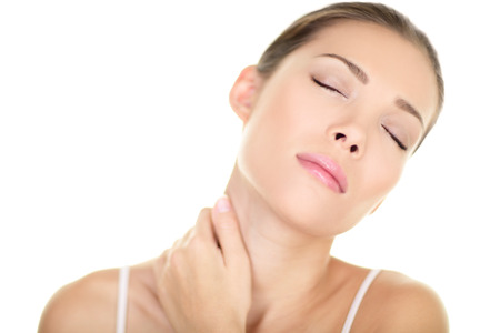 Neck pain muscle stress and strain - Unhappy tense stressed Asian woman massaging neck Massage and wellness concept with female beauty model isolated on white background Mixed race Asian Caucasian 版權商用圖片