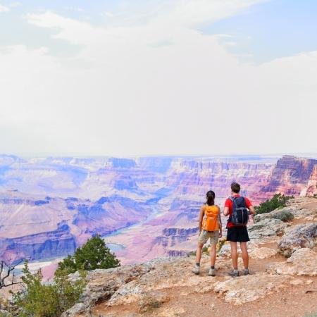 canyon: Grand Canyon - people hiking looking at view. Hiker couple walking on South Rim trail of Grand Canyon, Arizona, USA. Beautiful american landscape.