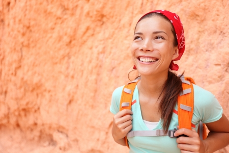 bryce: Hiking. Hiker woman portrait. Beautiful smiling girl wearing backpack looking around on hike in Bryce Canyon, Utah, United States. Fresh cheerful mixed race Asian Chinese  Caucasian model in her 20s Stock Photo