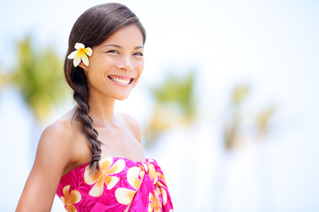Beach woman smiling happy in sarong - in joyful bliss on travel vacation  Pretty mixed race Asian Caucasian woman on Hawaiian beach resort  Hawaii, USA  photo