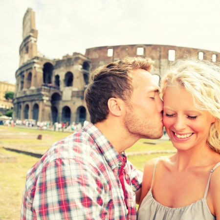 cute guy: Love - Couple kissing having fun in Rome by the Colosseum