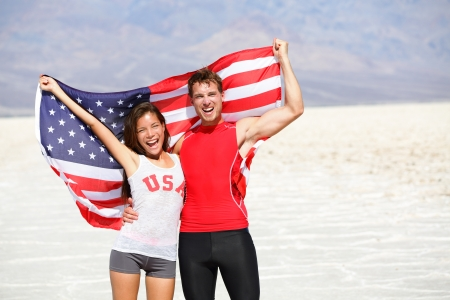 USA athletes people holding american flag cheering photo