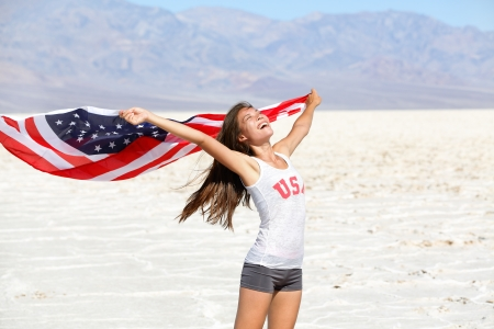 woman athlete showing american flag photo