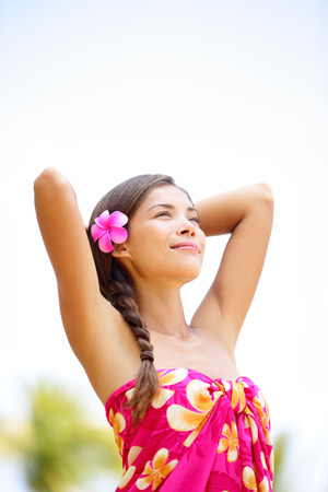 ethnic mixed race pretty serene woman in sarong relaxed enjoying holiday photo