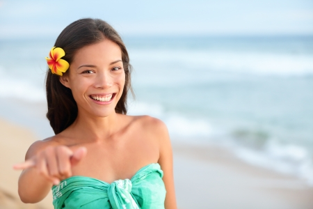 Hawaii beach smiling happy mixed race asian caucasian woman making shaka hand sign photo