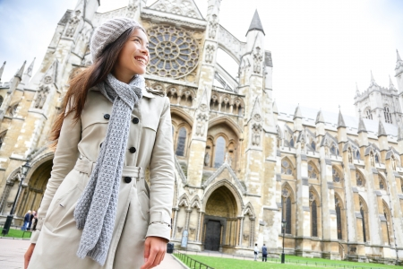 Westminster Abbey church London with young woman professional or tourist, England, Great Britain, UK.