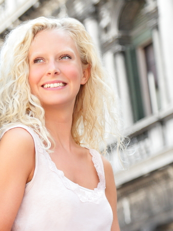 fresh girl: Beautiful blonde woman smiling happy portrait outside. Pretty fresh girl with long blond hair in her 20s. Stock Photo