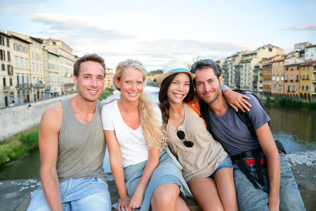 Friends - group of people on travel vacation having fun together. Two couples traveling in Florence, Tuscany, Italy, Europe. photo