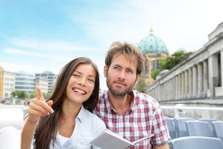 german girl: Travel tourist couple on boat tour in Berlin, Germany having fun smiling happy while enjoying romance on Europe travel vacation holiday. Asian woman, Caucasian man.