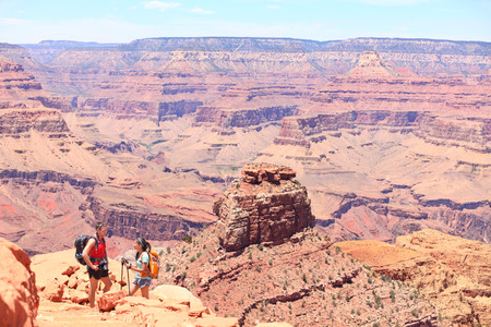south kaibab trail: Grand Canyon hiking people. Hiker couple enjoying hike and view on South Kaibab Trail, south rim of Grand Canyon, Arizona, USA. Stock Photo