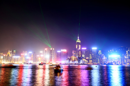 habour: Hong Kong skyline and Victoria harbor from Kowloon with colorful city lights at night. Stock Photo