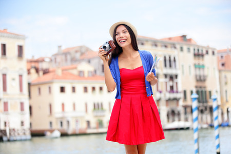 Travel tourist woman with camera and map in Venice, Italy.  photo