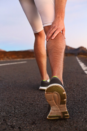 calf strain: Cramps in leg calves or sprain calf on runner. Sports injury concept with running man outside.