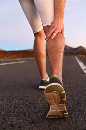 leg calf injury: Cramps in leg calves or sprain calf on runner. Sports injury concept with running man outside.
