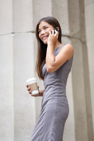 Business woman - young lawyer professional talking on smart phone. Mixed race Asian  Caucasian businesswoman smiling happy. photo