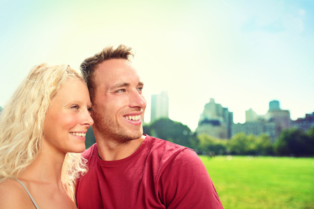 two couples: Young couple in New York City, Central Park. Portrait of happy lovers smiling looking to side at copy space. Beautiful young man and woman in their 20s.