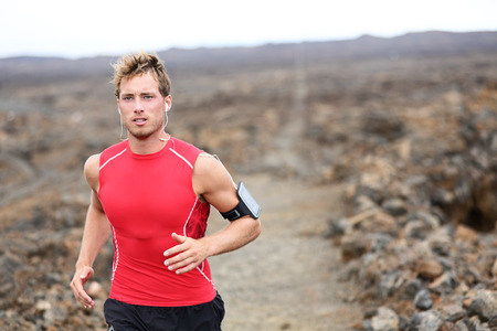 crosscountry: Man running cross country training outdoors  Stock Photo