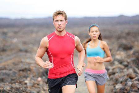 Running sport people jogging on trail in cross country run outdoors photo