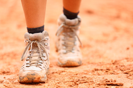 woman hiking: Woman hiker shoes walking on dirt trail hike path outdoor in nature.