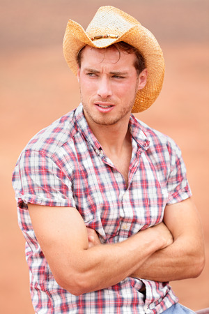 Cowboy man handsome and good looking with hat in rural USA countryside