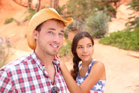 pocahontas: Couple portrait in american countryside outdoors. Smiling multiracial young couple in western USA nature