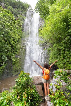 Woman cheering during travel on the road to Hana on Maui, Hawaii photo