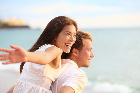 Romantic couple having fun on beach on honeymoon travel vacation summer holidays romance photo