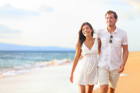 Couple walking on beach on romantic travel honeymoon vacation summer holidays romance photo