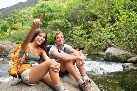 hawaiian girl: Hiking people in outdoor activity wearing backpacks relaxing Stock Photo