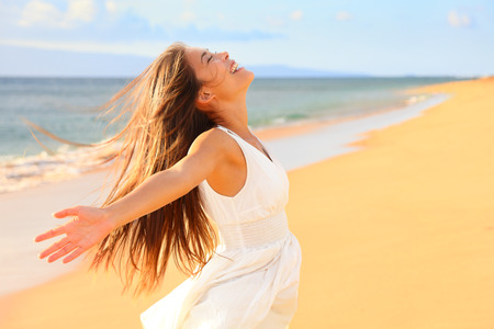 nature natural: Free happy woman on beach enjoying nature. Natural beauty girl outdoor in freedom enjoyment concept. Mixed race Caucasian Asian girl posing on travel vacation holidays in dress. Stock Photo